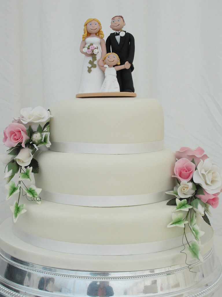 Simple 3 tier Wedding Cake with a Topper and Sugar Sprays