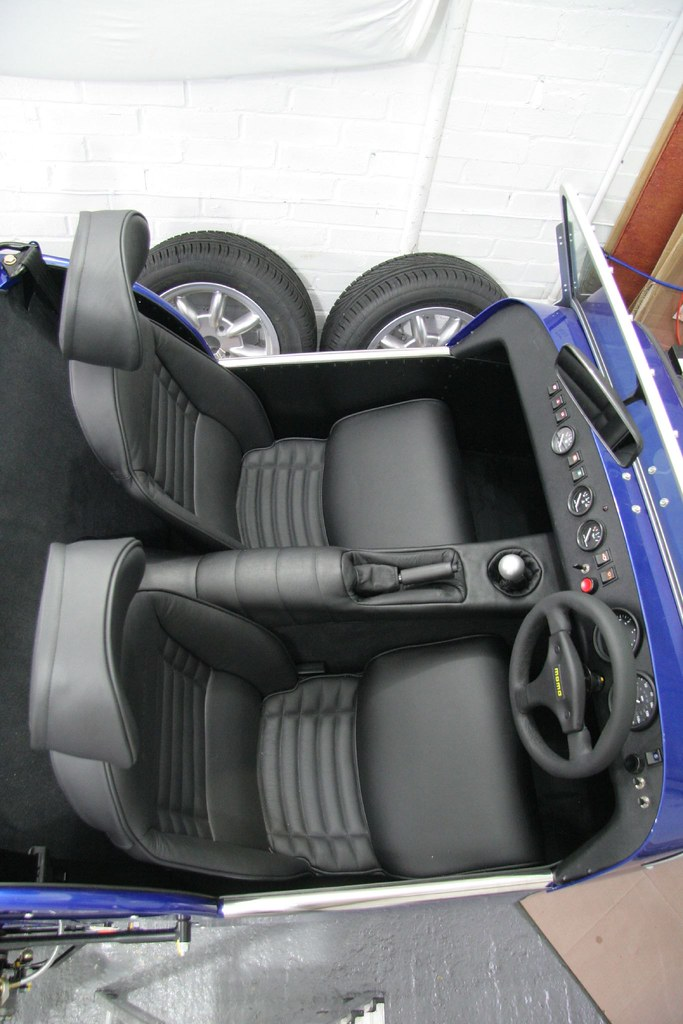 Fit carpets, transmission tunnel cover, gear lever knob an