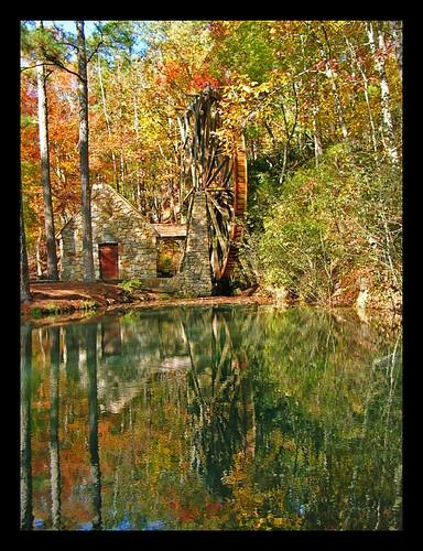reflection building history mill nature pool wheel forest landscape reflecting pond historic grounds waterwheel millhouse berrycollege fieldstone watertravelromegeorgiausaautumnfallnovembernikoncoolpixjgraceystinsonseasons