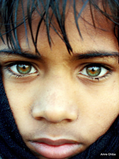 Green-eyed indian boy during Ardh Kumbh Mela |The most beautiful eyes | My National Geographic cover portrait | Somehow related to Mc Curry's Afghan Girl with beautiful green eyes ? | by Aucunale TNT