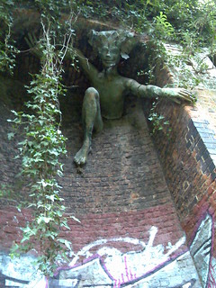 Statue fixed to wall in Parkland Walk | by markhillary