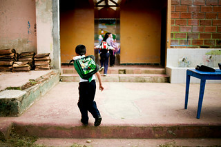 A young student runs to class | by World Bank Photo Collection
