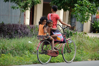 Cambodian Kids & Mother on Bike | by goingslowly