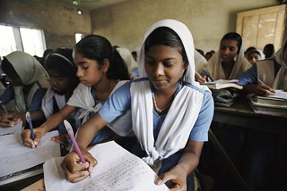 High school girls taking notes | by World Bank Photo Collection