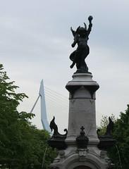 statue and Erasmusbridge