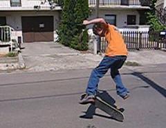 Andrew doing a kick flip