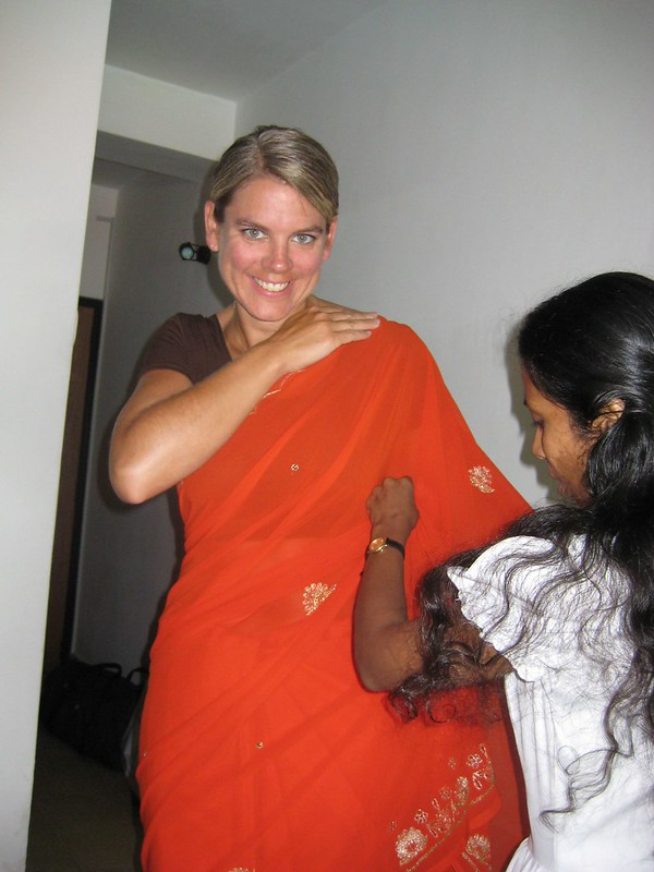maureen putting on saree w/ help