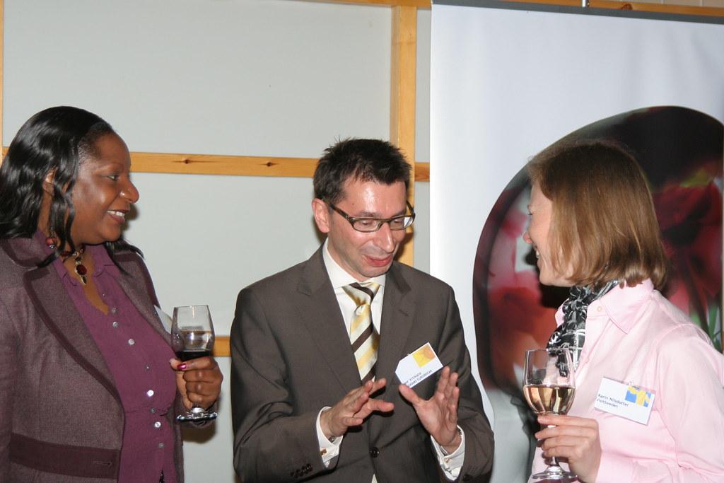 Igor Vrtikapa And Colleague Chatting With Karin Nilsdotter