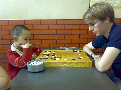 Kalle plays go with a Chinese kid | by Aleksi Aaltonen