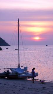 the sun setting over sunset beach, ko lipe | by hopemeng