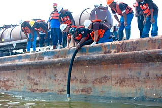 Workers attempt to Vacuum the Oil from the Gulf