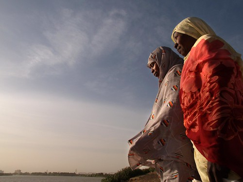 Two women look out over the White Nile   by World Bank Photo Collection