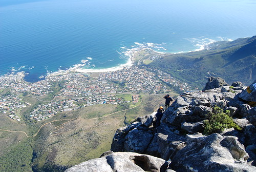 Abseilers prepare to drop down from Table Mountain, Cape Town, South Africa   by Paul Mannix