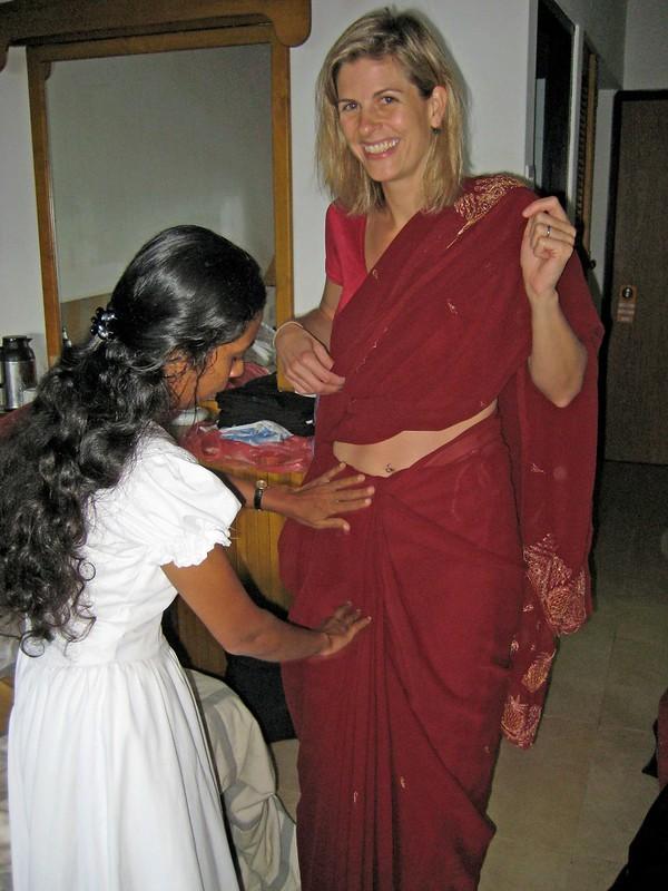 cassie putting on saree w/ help