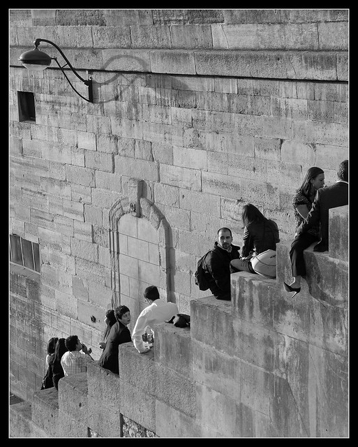 Paris - people sitting at the steps near the Seine river