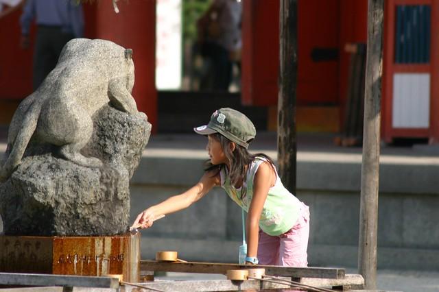 A kid washing hands - Kyoto, Japan, 2007.