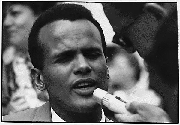 Public Domain: Harry Belafonte at 1963 March on Washington (NARA)