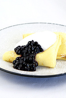 crepes with blueberry sauce and cream