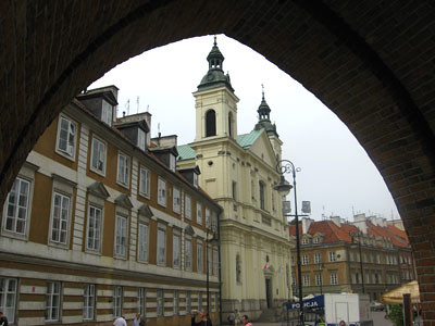 Church viewed from an ancient gate in Warsaw | by the Italian voice