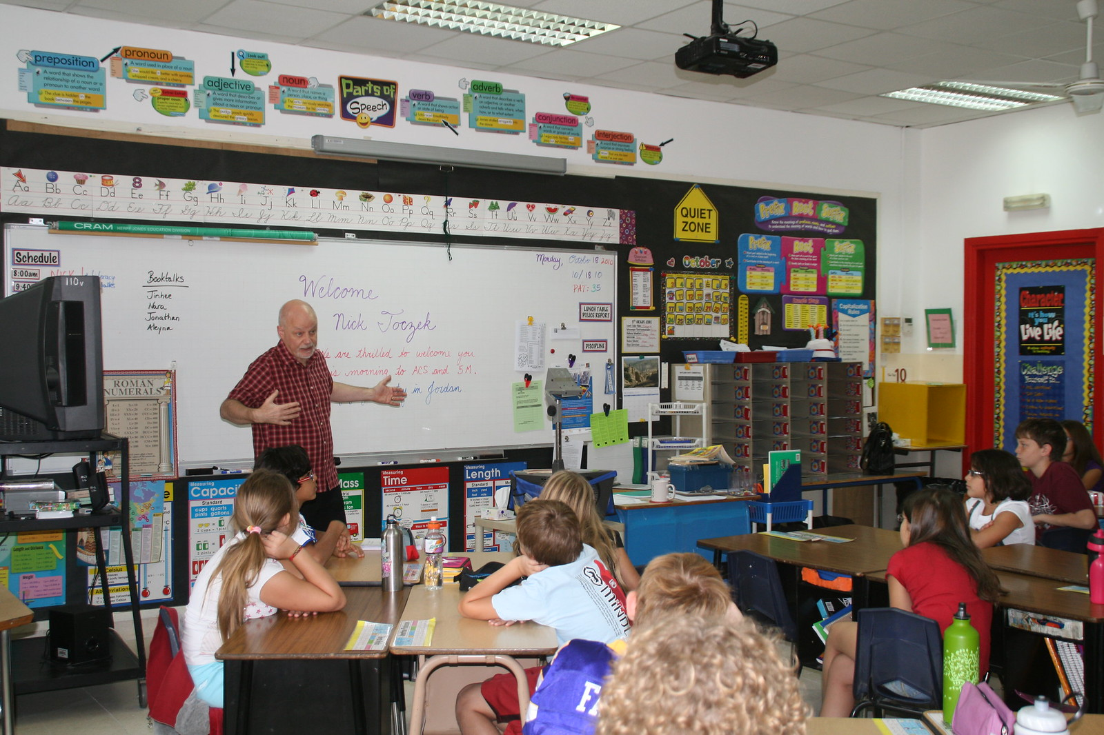 Teacher in front of K-12 class