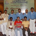 Mr. Uday Kumar one of the chief referees posing with the players