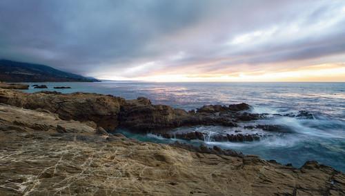 sunrise rocks waves leocarrillo