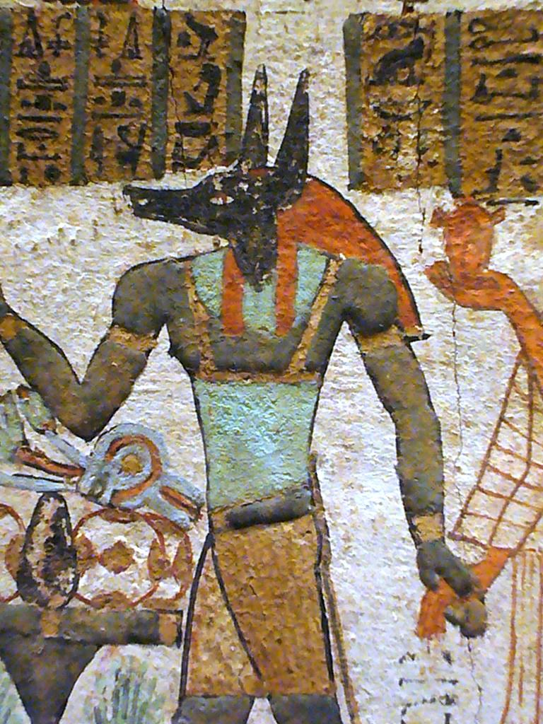Ancient Egyptian wall painting depicting Anubis