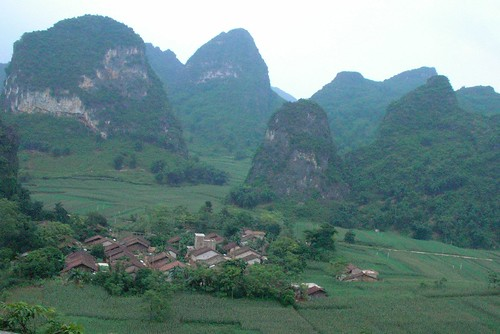 farming village surrounded by karst mountains | by Rex Pe
