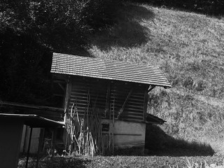 a barn tired of time and drunken hills
