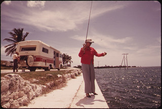 A Retired Couple From California Stop to Fish Off Embankment at Spanish Harbor Key. Travel-Trailers of the Kind Owned by This Couple Are Highly Popular Among Visitors to the Keys. | by The U.S. National Archives