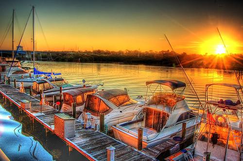 ocean usa sun beach america sunrise boats saturated rocks tampabay florida deleteme10 indian united 2006 indianrocksbeach nikond50 states hdr photomatix 5xp hamlinslanding worldwidewandering