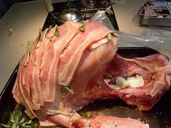 the alien turkey being wrapped in bacon | by emmavn