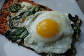 leftover Fornino spinach pizza with a fried farm egg on top for breakfast   by kthread