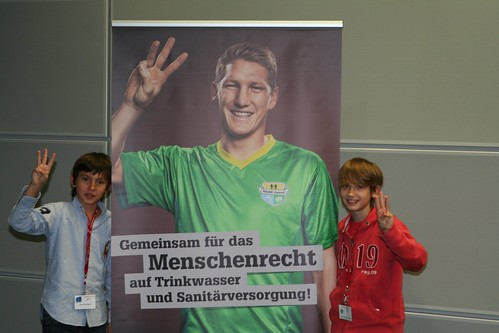 Children posing with a poster of soccer superstar (now World Champion) Sebastian Schweinsteiger for human right to water and sanitation (WASH United) - Oct. 2010 | by Sustainable sanitation