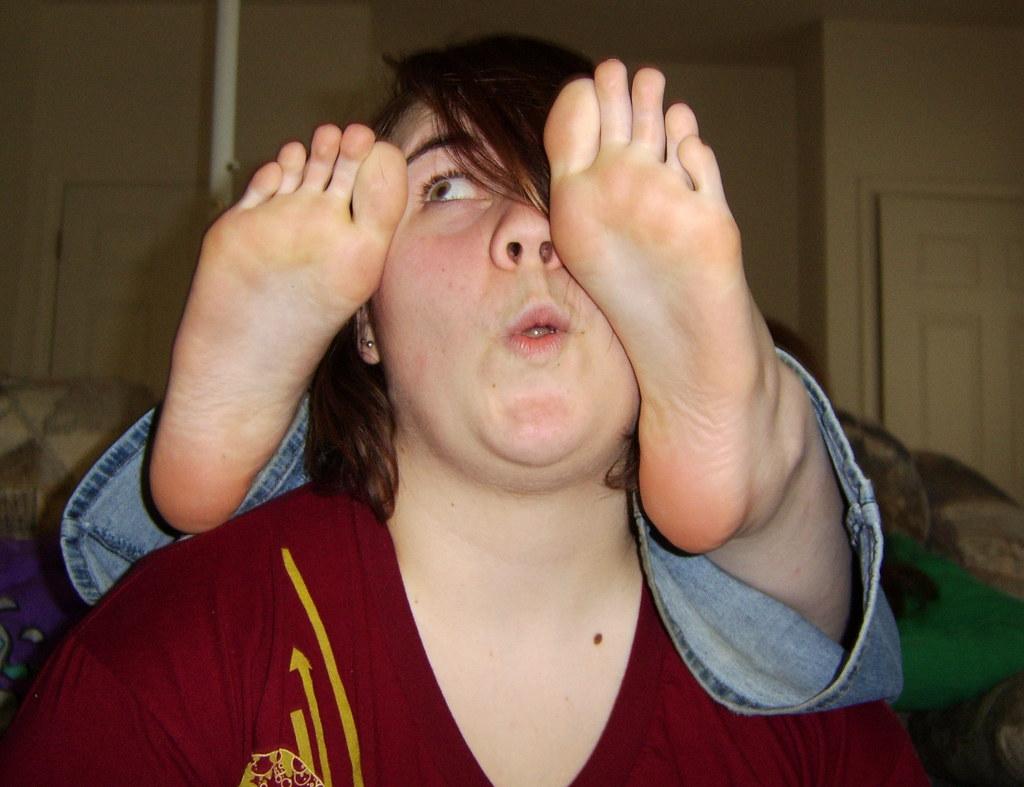 Feet on a face