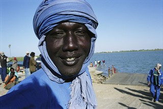 Young man on bank of Senegal River.   by World Bank Photo Collection