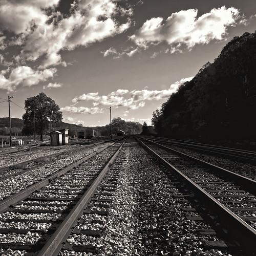 blackandwhite bw monochrome clouds aperture nikon westvirginia blueskies goldenhour railroads railroadtracks railyards wva d300 csxrailroad hancockmaryland 1755nikkor berkeleyspringswestvirginia shaadows niksofware diminishingperspectives sepiamountains westernmarylalnd
