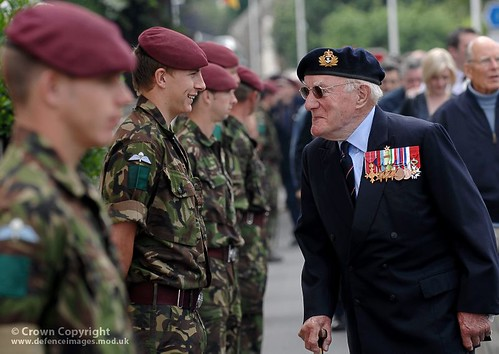 A Royal Navy Veteran Shares a Joke With a Young Paratrooper | by Defence Images
