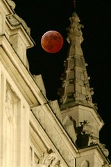A Lunar Eclipse is seen over the Westminster Abbey in London | by johnhanscom
