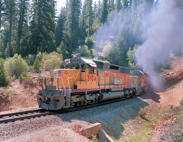 3,000 horsepower EMD-built SD40 locomotive 3104 leads a Union Pacific northbound freight train near Westwood and Lake Almanor, California, on the