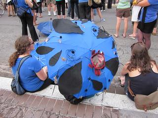 BP Dead Pelicans Umbrella Curb Sitting