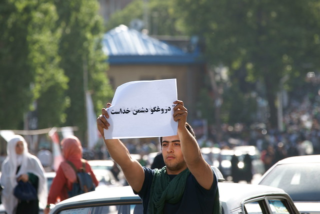 Liar is Enemy of God, held by A Supporter of Mir Hossein Mousavi in Tajrish Square, Teheran, Iran (Persia)