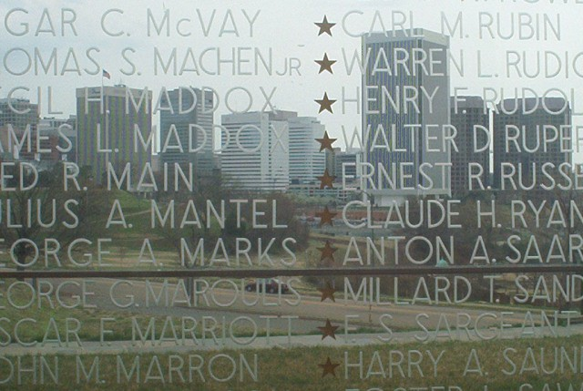 Downtown from inside the War memorial with the names engraved on the glass