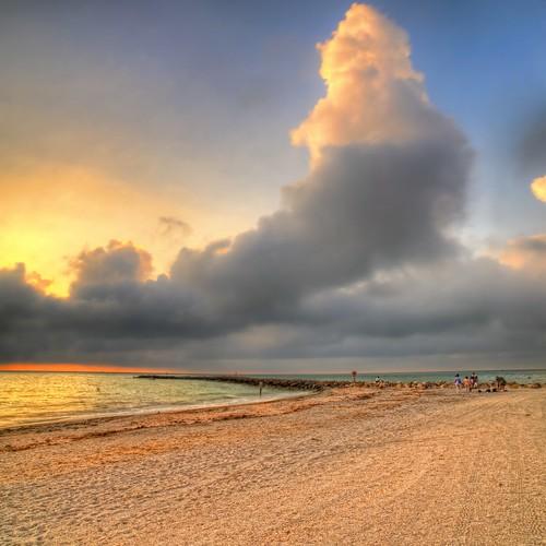ocean sunset summer portrait beach gulfofmexico clouds evening photo rocks waves photographer florida dusk jetty clearwaterbeach hdr highdynamicrange clearwater pinellascounty sandkey vertorama andrewvernon nikond300s aperture3 sandkeystatepark