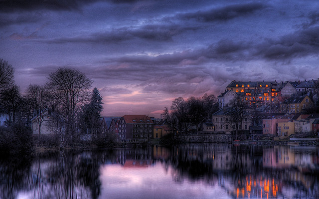 Sunset reflecting in the windows by Amundn
