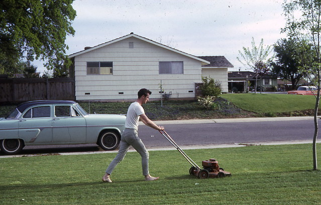 barefoot mowing in skinny jeans