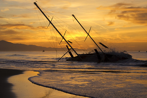 sailboat nautical eastbeach santabarbara california sunrise silhouette waves nikon d80 clouds nikond80 january 2010 geotagged free creativecommons