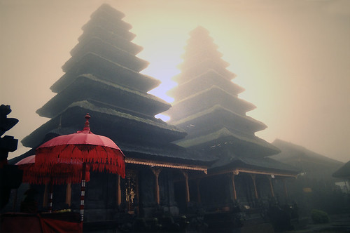 Bali temple with red umbrella