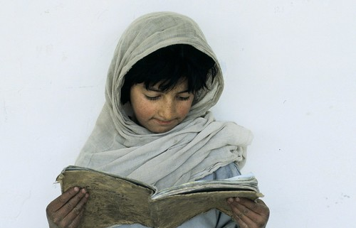 Young girl reading | by World Bank Photo Collection