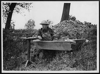 Signaller with his instruments makes himself a comfortable seat in an old bath tub | by National Library of Scotland